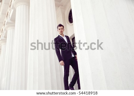 portrait of a handsome elegant young man - stock photo