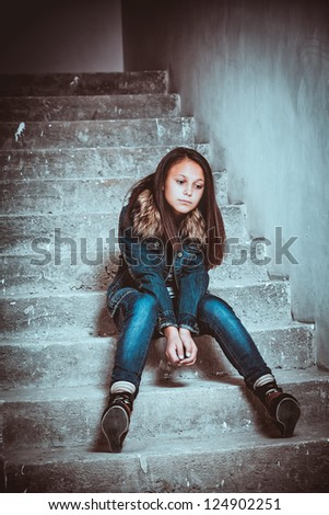 portrait of a sad teenage girl looking thoughtful about troubles - stock photo