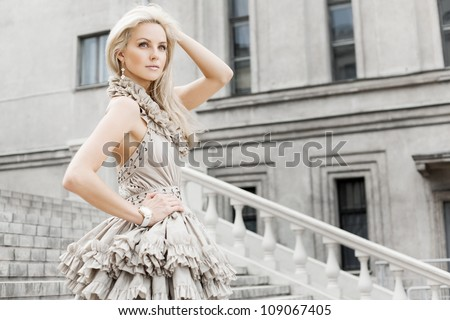 Portrait of  a young girl is walking. Outdoors - stock photo