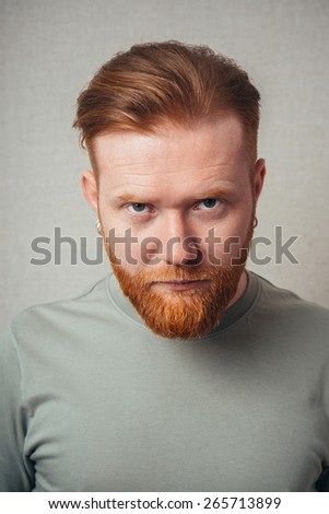 portrait of a Young red bearded Man feel bad, sad