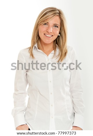 Portrait of an attractive smiling blonde woman in white shirt - stock photo