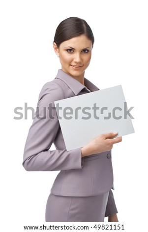 Portrait of an attractive young business woman holding an empty billboard - stock photo