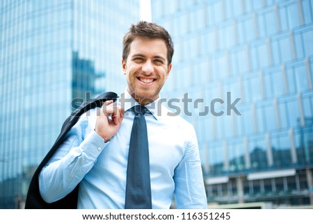 Portrait of an handsome businessman outdoor in the city - stock photo