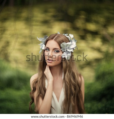 Portrait of attractive beautiful blonde woman in greek style grain and texturer added - stock photo