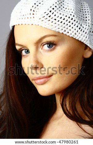 Portrait of beautiful brunette woman with beret - stock photo