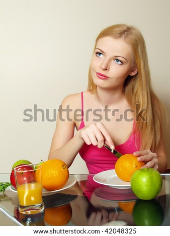 Portrait of beautiful girl with vegetable and fruit