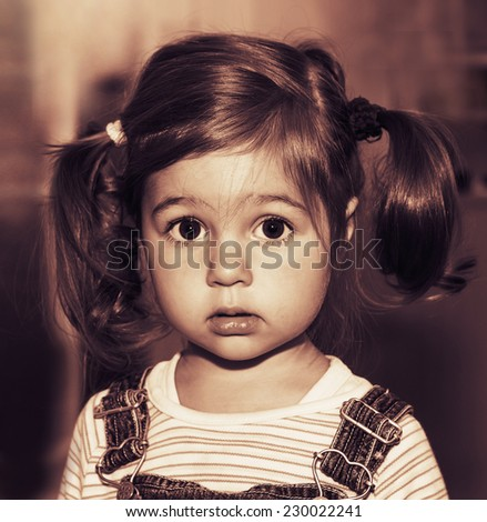 Portrait of cute sad little girl thinking. Toned - stock photo