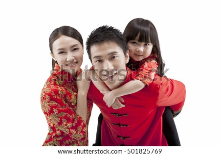 Portrait of family,father carrying daughter on back,in Tang suits