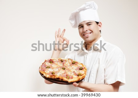 Portrait of happy attractive cook with a pizza in hands