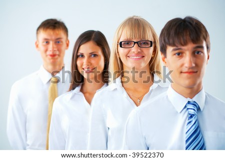 Portrait of happy business group standing in a row - stock photo