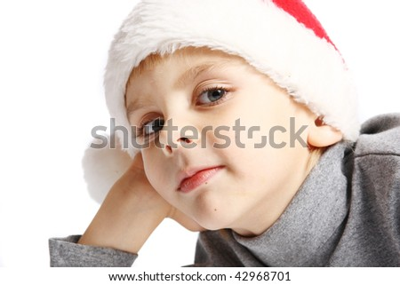 Portrait of little boy  in santa hat  on white background - stock photo