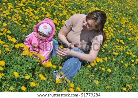 portrait of mother and daughter on the grass