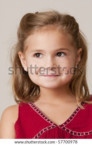 Portrait of pretty little 5 year old girl with blond hair and red dress. - stock photo
