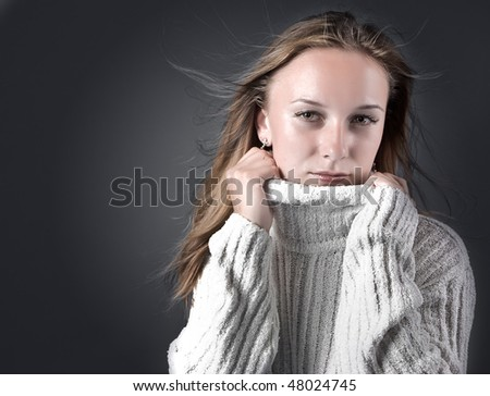 Portrait of pure beautiful woman wearing winter warm clothing over white - stock photo