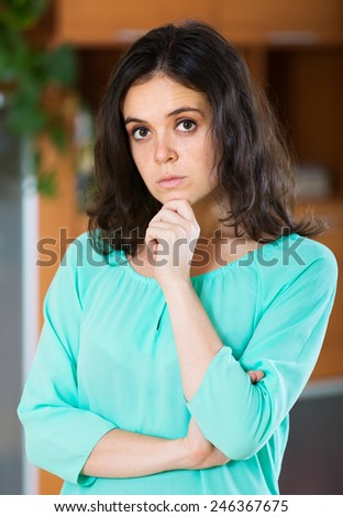 Portrait of sad woman  at  home - stock photo