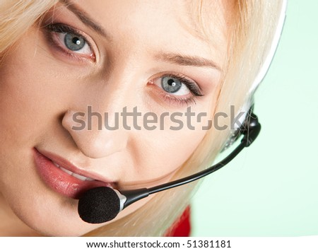 Portrait of secretary woman in headset isolated over white