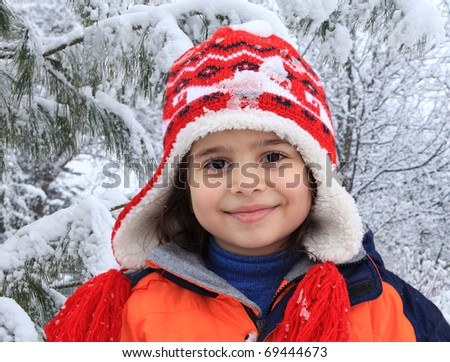 portrait of smiling girl in the winter park