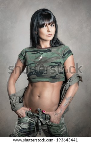 Portrait of stylish woman in military clothes - stock photo
