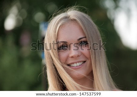 Portrait of the beautiful blonde - stock photo