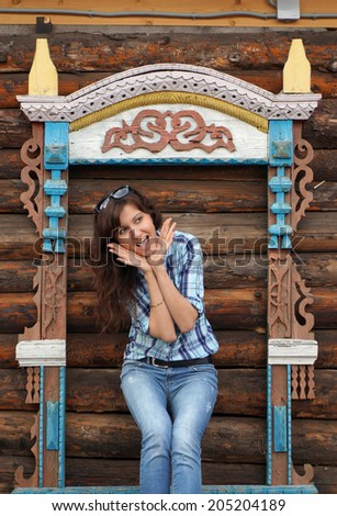 Portrait of the beautiful girl travelling in Rostov , Carved wooden platbands - stock photo