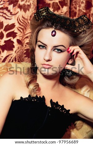 Portrait of the beautiful young woman in the vintage style - stock photo