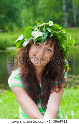 Portrait of the beautiful young woman in Wreath from birch leaves - stock photo