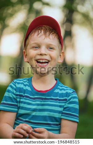 Portrait of the cheerful boy - stock photo