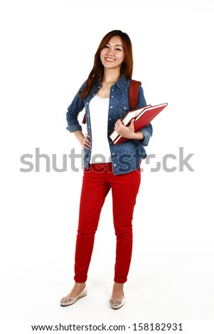 Portrait of young Asian student, isolated on white background - stock photo