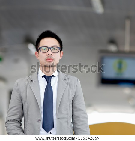 Portrait of young business man of Asian - stock photo