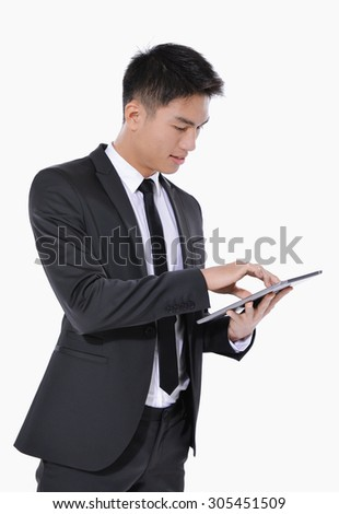Portrait of young businessman Using Digital Tablet Isolated   - stock photo