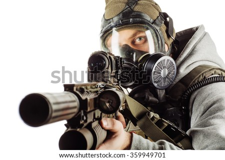portrait of young rebel with gas mask aiming with rifle