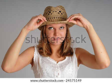 portrait of  young woman in a  straw  hat - stock photo