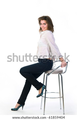 portrait of young woman sitting on bar chair