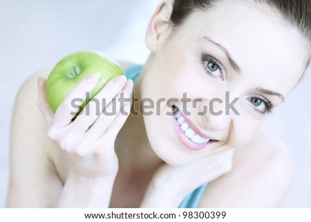 portrait of young woman with apple - stock photo