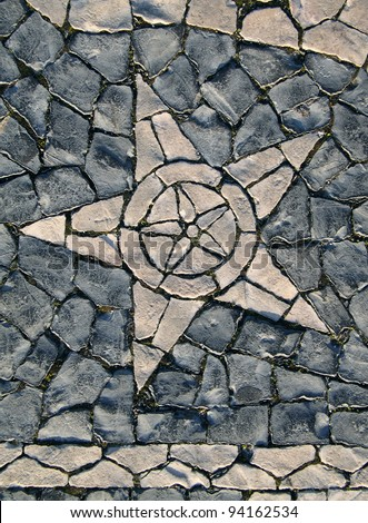 """Portugal Lisbon Belem District typical Portuguese mosaic """"calcada"""" paving stones depicting a star - stock photo"""