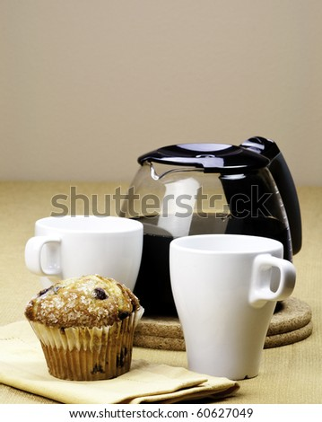 Pot of Coffee and muffin - stock photo