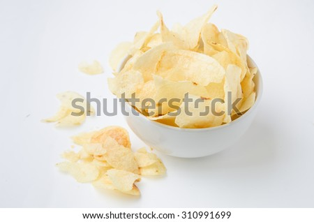 Potato chips bowl isolated on white, clipping path included - stock photo