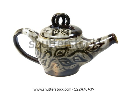 Pottery and ceramic works by Oksana Litvinova. Beautiful ceramic teapot for brewing tea isolated on white background