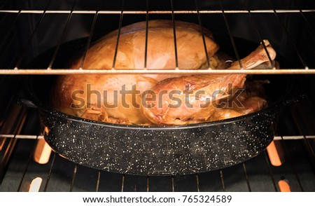 25 pound turkey roasting in the oven.