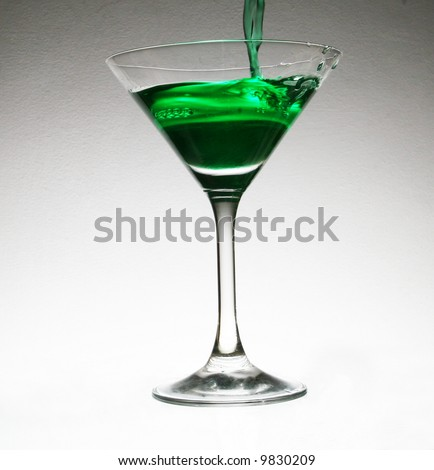 pouring  cocktail in glass
