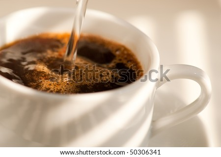 Pouring Coffee into a cup - stock photo