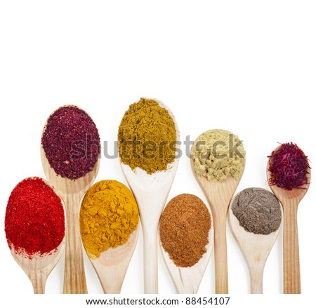 powder spices on spoons isolated  on a white background - stock photo