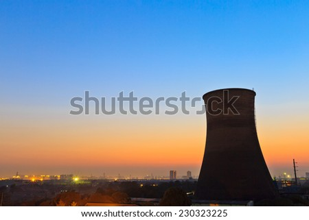 power plant chimney silhouette background at dusk