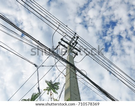 Power poles with bright sky.
