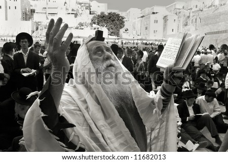 Prayer old rabbi at the Western Wall in Jerusalem on the day of 9 avva. - stock photo