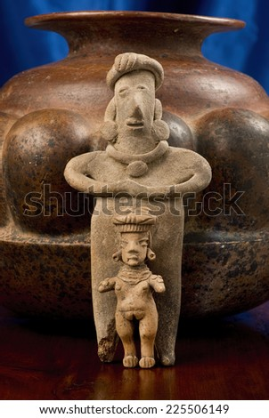 Pre Columbian Colima Mother and Daughter figures made around 200 BC to 200 AD. - stock photo