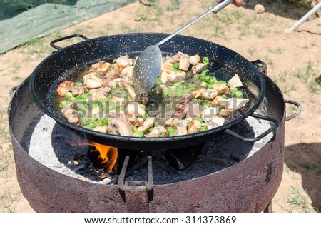 Preparation step of authentic Paella Valenciana in the field