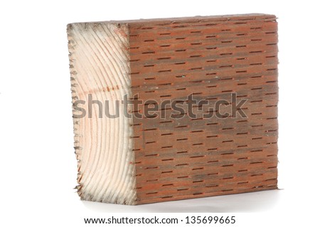 Pressure Treated Western Red Cedar Wood showing incising to let the dark chemical preservative soak in. - stock photo