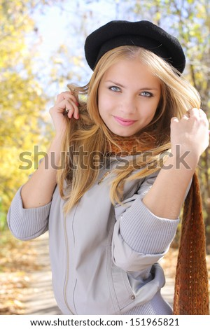 pretty blond young girl standing in a Park - stock photo