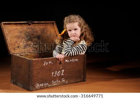pretty little girl on the studio background - stock photo